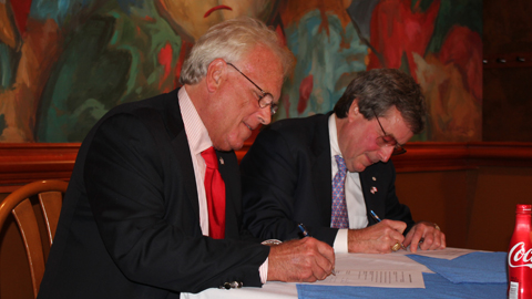 Bisons owner Bob Rich and Blue Jays president and CEO Paul Beeston sign on the dotted line.